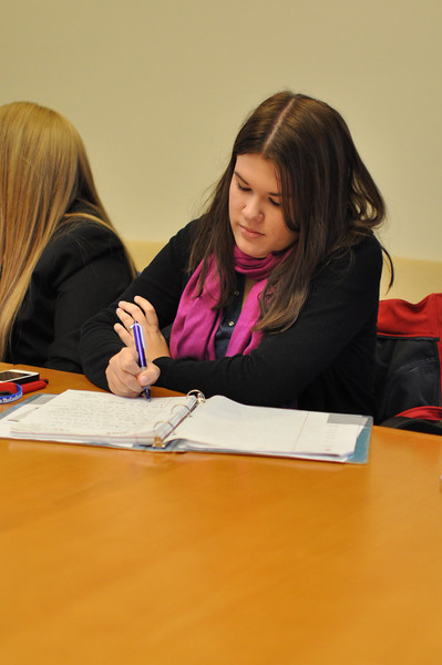 Allison Drenan taking notes during a small group discussion