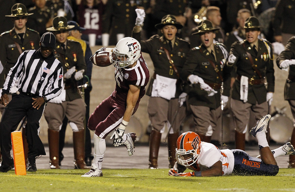 . Travis Labhart #15 of the Texas A&M Aggies scores on a 44 yard reception in the first quarter against the UTEP Miners at Kyle Field on November 2, 2013 in College Station, Texas.  (Photo by Bob Levey/Getty Images)