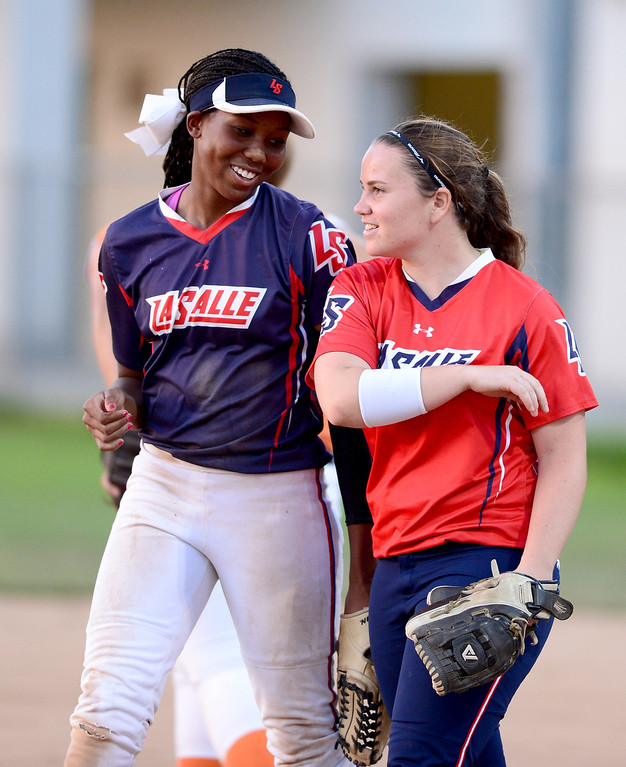 . La Salle\'s Kinsley Washington and Kennedy Cribbs high five during the West SGV softball all-star game Wednesday night, June 11, 2014 at Live Oak Park in Temple City. (Photo by Sarah Reingewirtz/Pasadena Star-News)