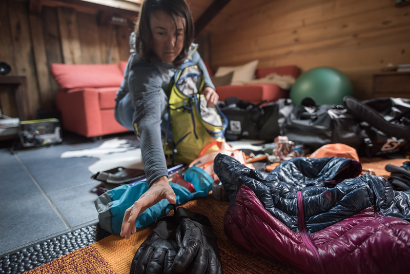 Liv Sansoz packing gear for an Alpine climb, Chamonix