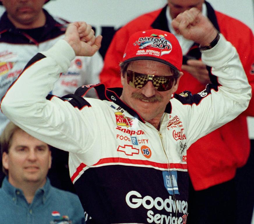 . Dale Earnhardt, from Kannpolis, N.C., has Victory Lane reflected in his sunglasses as he celebrates winning the Daytona 500 Sunday afternoon, Feb. 15, 1998, at the Daytona International Speedway in Daytona Beach, Fla. (AP Photo/Terry Renna)