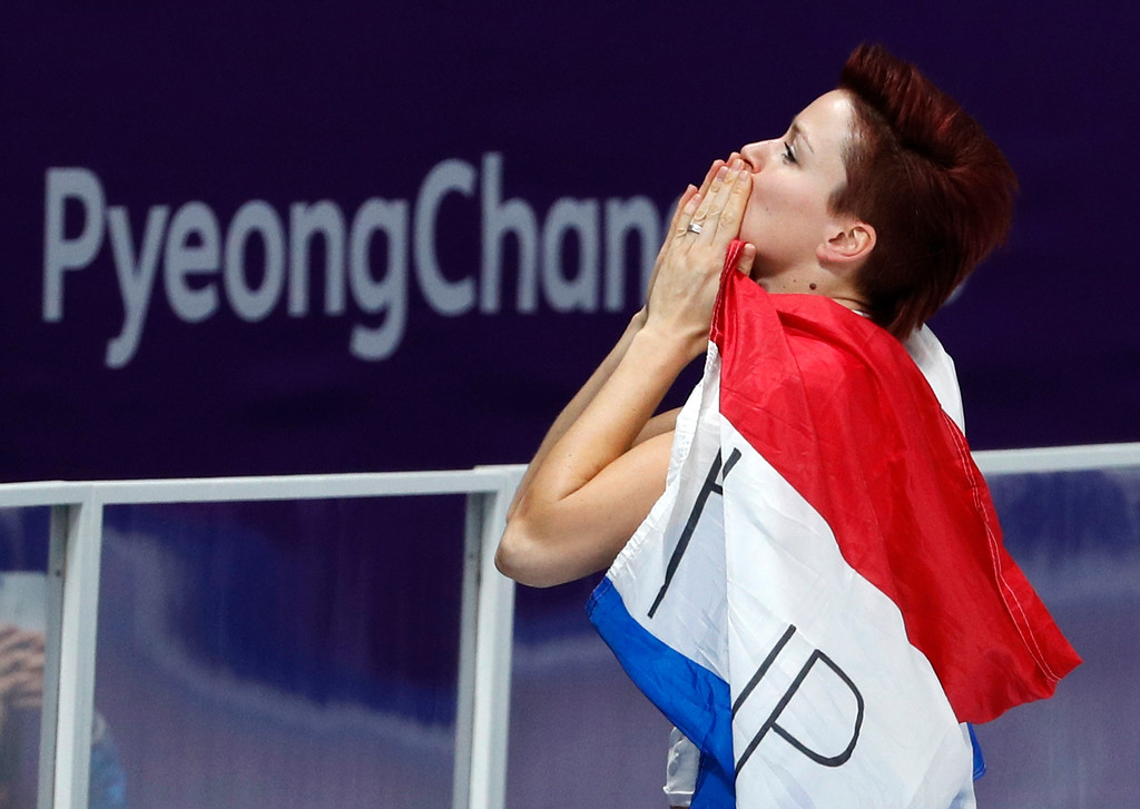 . Gold medallist Jorien ter Mors of The Netherlands celebrates with the national flag after the women\'s 1,000 meters speedskating race at the Gangneung Oval at the 2018 Winter Olympics in Gangneung, South Korea, Wednesday, Feb. 14, 2018. (AP Photo/John Locher)