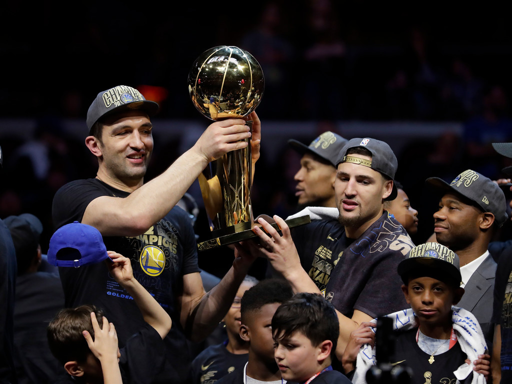 . Golden State Warriors\' Zaza Pachulia, left, and Klay Thompson hold the trophy after the Warriors defeated the Cleveland Cavaliers 108-85 in Game 4 of basketball\'s NBA Finals to win the NBA championship, Friday, June 8, 2018, in Cleveland. (AP Photo/Tony Dejak)