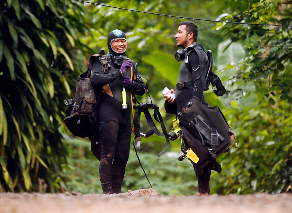 . Thai rescuers prepare for diving after the 12 boys and their soccer coach were found alive, in Mae Sai, Chiang Rai province, in northern Thailand, Tuesday, July 3, 2018. The 12 boys and soccer coach found after 10 days are mostly in stable medical condition and have received high-protein liquid food, officials said Tuesday, though it is not known when they will be able to go home. (AP Photo/Sakchai Lalit)