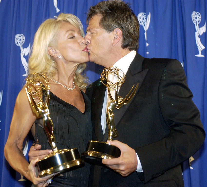 . Linda Thompson, left, and David Foster kiss backstage after receiving the award for \'Outstanding Music and Lyrics\' for their work on the song \'Aren\'t They All Our Children\' for The Concert for World Children\'s Day at the Emmy Creative Arts Awards at the Shrine Auditorium in Los Angeles on Saturday, Sept. 13, 2003. (AP Photo/Matt Sayles)