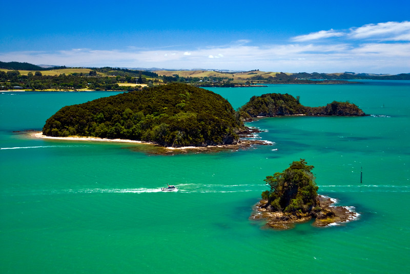 A fishing boat makes its way out of Paihia and into the Bay the Islands