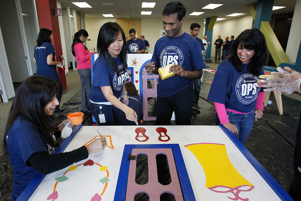 . From left, NetScout Systems employees Shalini Das, Rosario Guiang, Venkata Vuyyuru and Janet Birdi construct a playhouse that was donated to families in the Blue Star Mom organization at the NetScout offices in San Jose, Calif. on Thursday, Feb. 21, 2013.   (LiPo Ching/Staff)