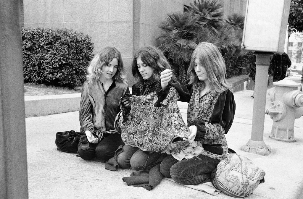 . Three followers of Charles Manson work on a multi-colored vest intended for the leader of the hippie-style clan who is on trial for murder, along with three other women followers, Jan. 24, 1971. Women members of the group have been camping outside the Los Angeles courthouse where the seven-month-long trial is nearing its end. Left to right: Sandy Good, Brenda McCann and Kitty Lutesinger. (AP Photo/David F. Smith)