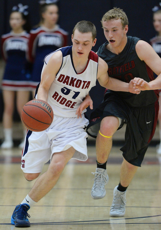 . LITTLETON, CO. - JANUARY 17: Chatfield\'s Darius Reiter (30) chased Dakota Ridge guard Mason Grothuesmann (31) down the court in the first half. The Dakota Ridge High School boy\'s basketball team hosted Chatfield Friday night, January 16, 2014. Photo By Karl Gehring/The Denver Post