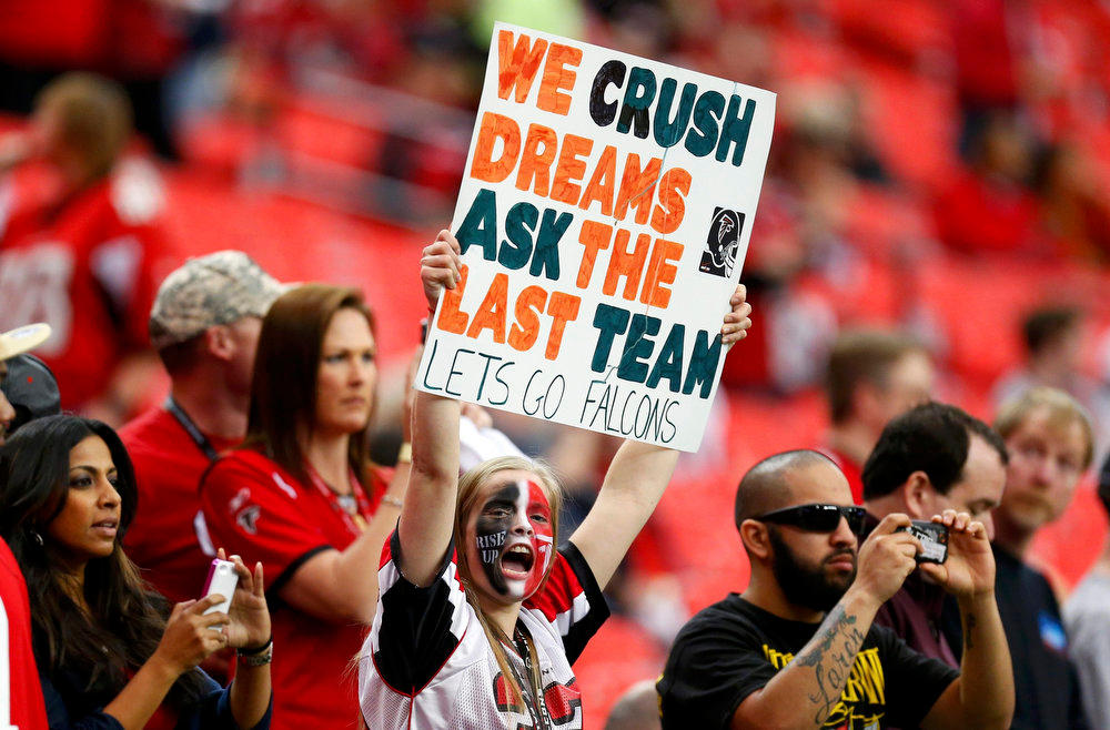 Description of . An Atlanta Falcons fan holds up a sign as she awaits the start of the NFL NFC Championship football game against the San Francisco 49ers in Atlanta, Georgia January 20, 2013.  REUTERS/Chris Keane