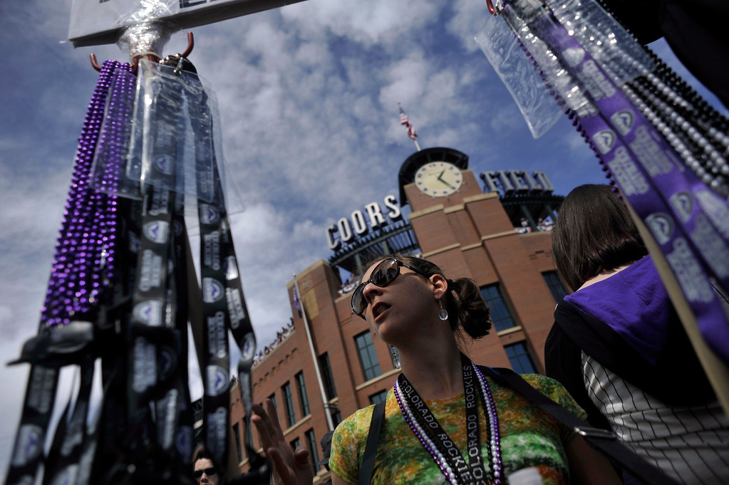 . DENVER, CO. - APRIL 05: Heather Davis of Colorado Springs sells Rockies memorabilia outside of Coors Field on opening day of the season. The Colorado Rockies defeated the San Diego Padres 5-2 in their home opener at Coors Field in Denver, Colorado on Friday, April 5, 2013. (Photo By Patrick Traylor/The Denver Post)