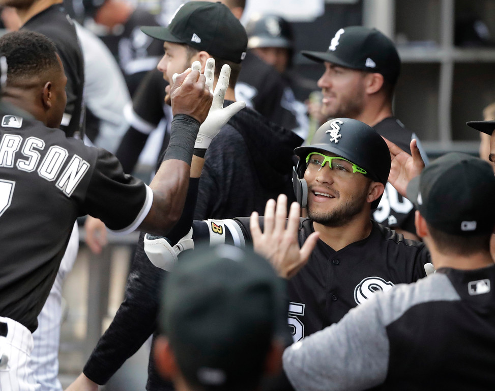 . Chicago White Sox\'s Yolmer Sanchez is congratulated for his home run off Cleveland Indians starting pitcher Adam Plutko during the first inning of a baseball game Tuesday, June 12, 2018, in Chicago. (AP Photo/Charles Rex Arbogast)
