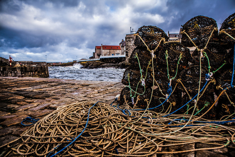 Lobster pots at Portsoy Harbour, Aberdeenshire, Scotland.