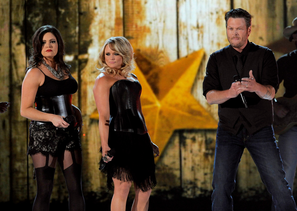 . From left, Angaleena Presley and Miranda Lambert of musical group Pistol Annies, and singer Blake Shelton perform at the 48th Annual Academy of Country Music Awards at the MGM Grand Garden Arena in Las Vegas on Sunday, April 7, 2013. (Photo by Chris Pizzello/Invision/AP)