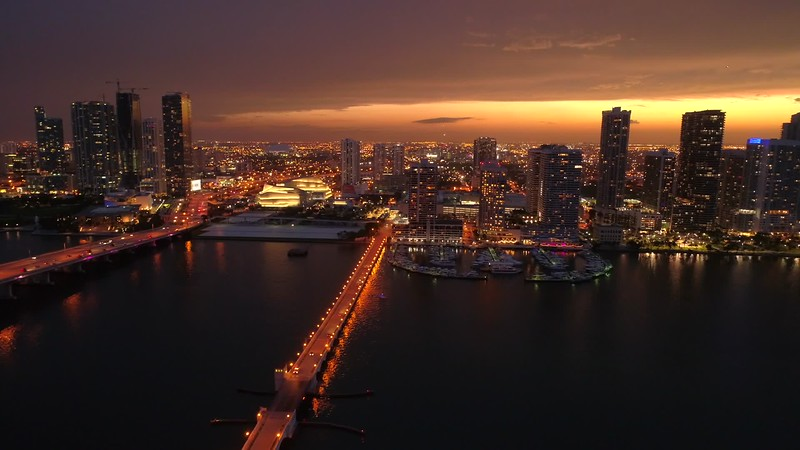 Aerial b roll glowing city and sunset Miami Florida night