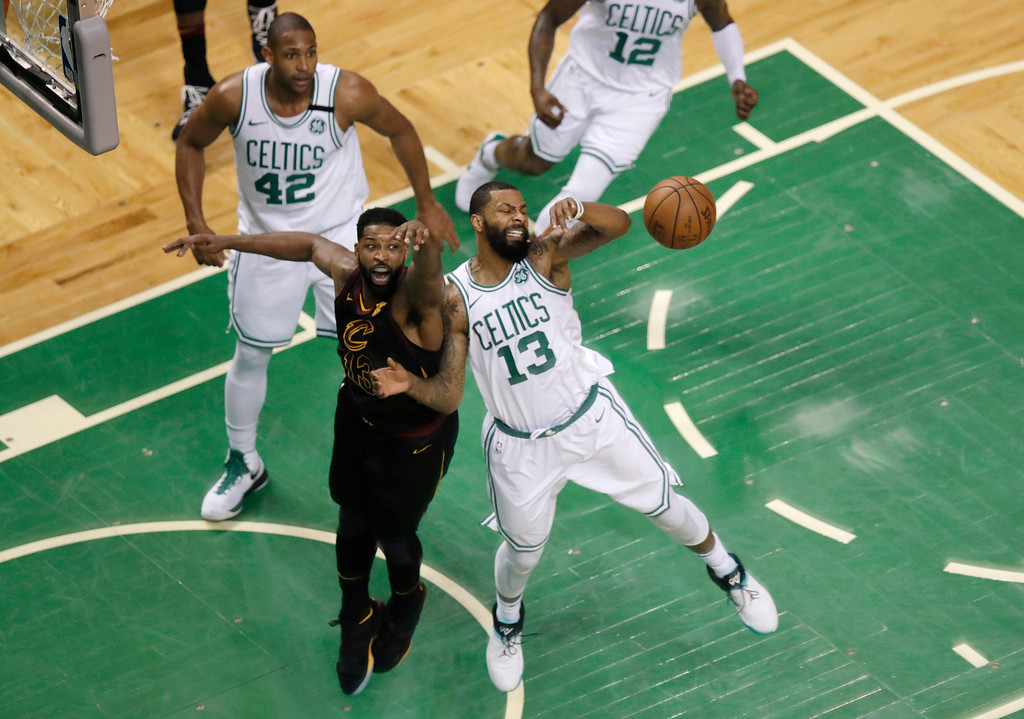 . Cleveland Cavaliers center Tristan Thompson, front left, and Boston Celtics forward Marcus Morris, right, fight for the ball during the first half in Game 7 of the NBA basketball Eastern Conference finals, Sunday, May 27, 2018, in Boston. (AP Photo/Charles Krupa)