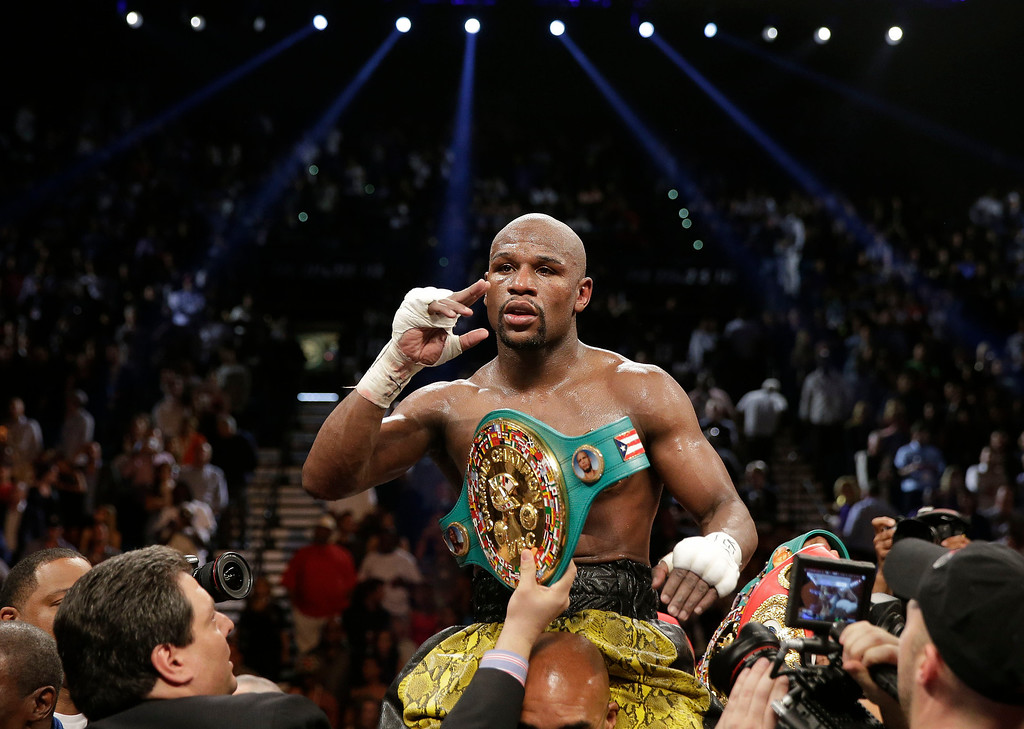 . Floyd Mayweather Jr. reacts after defeating Robert Guerrero by unanimous decision during a WBC welterweight title fight, Saturday, May 4, 2013, in Las Vegas. (AP Photo/Isaac Brekken)
