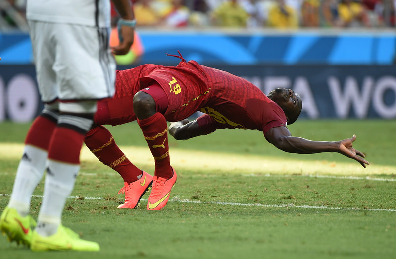 . Ghana\'s defender Jonathan Mensah falls during a Group G football match between Germany and Ghana at the Castelao Stadium in Fortaleza during the 2014 FIFA World Cup on June 21, 2014.  (PATRIK STOLLARZ/AFP/Getty Images)