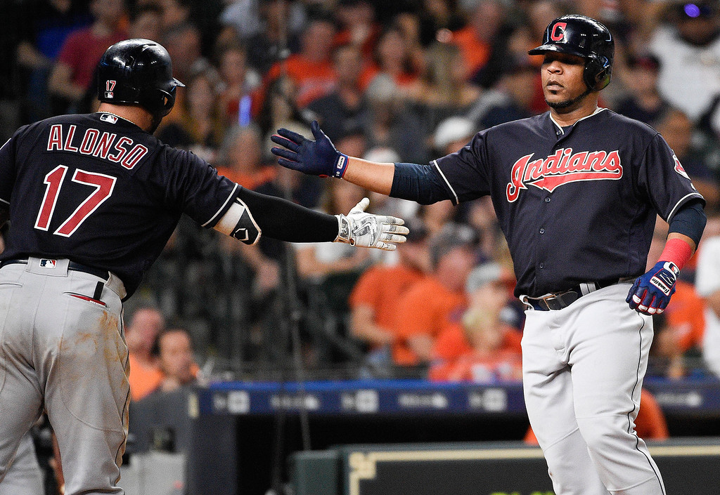 . Cleveland Indians designated hitter Edwin Encarnacion, right, celebrates his solo home run off Houston Astros starting pitcher Charlie Morton with Yonder Alonso during the seventh inning of a baseball game, Friday, May 18, 2018, in Houston. (AP Photo/Eric Christian Smith)