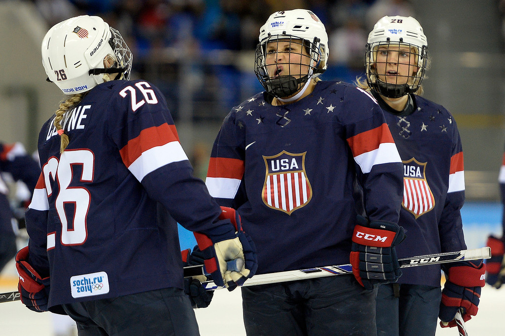 . Brianna Decker (14) of the U.S.A. and Kendall Coyne (26) of the U.S.A. talk during a break against Switzerland in the second period of action at the Shayba Arena. Sochi 2014 Winter Olympics on Monday, February 10, 2014. (Photo by AAron Ontiveroz/The Denver Post)