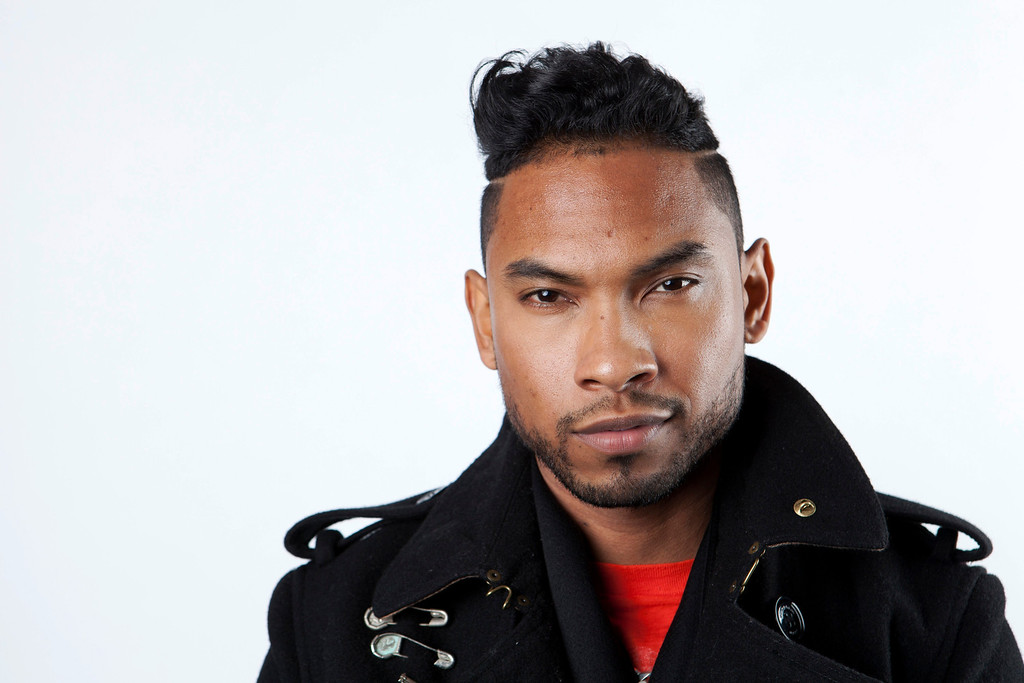 """. FILE - In this Jan. 4, 2013 file photo, American recording artist, songwriter and producer, Miguel, poses for a portrait, in New York.  Miguel is nominated for two awards at Sunday\'s Grammys, including best R&B performance for \""""How Many Drinks?\"""" with Kendrick Lamar. The 56th annual Grammy Awards are held Jan. 26, 2014, at the Staples Center, in Los Angeles. (Photo by Amy Sussman/Invision/AP, File)"""