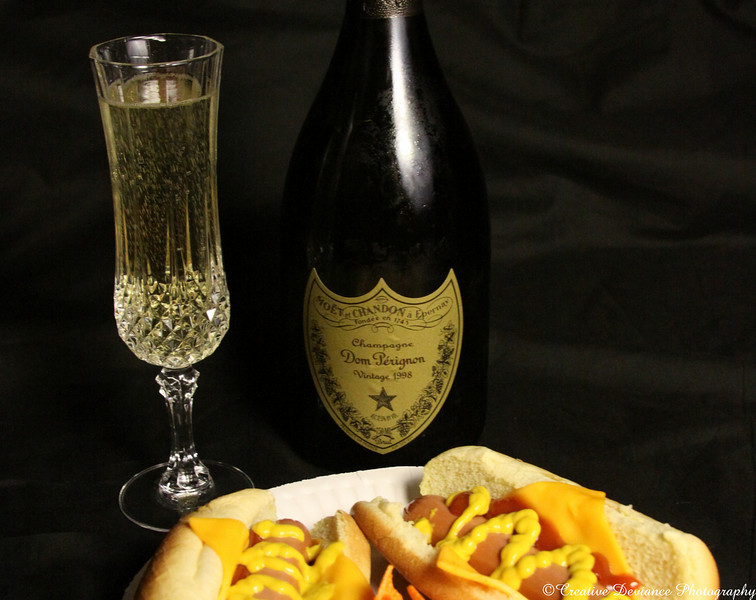 November 5, 2009  This photo was taken a while ago, but was never uploaded. I got this bottle of Dom for Christmas a few years ago, but I was pregnant with my little monkey.  By the time we opened it, we really didnt have any thing fancy to celebrate, so we decided to be silly.   What better to have with hotdogs? A meal fit for a king.