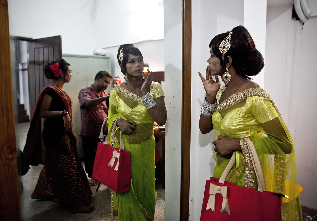 . Hijras (transgender)  get ready backstage before the Hijra talent show, part of the first ever event called Hijra Pride 2014, on November 10, 2014 in Dhaka, Bangladesh.  In 2013 Bangladesh officially recognized Hijras as a third gender, though homosexuality still remains illegal. Despite these strides Hijras continue to face violence and harassment as part of their daily life in Bangladesh. (Photo by Allison Joyce/Getty Images)