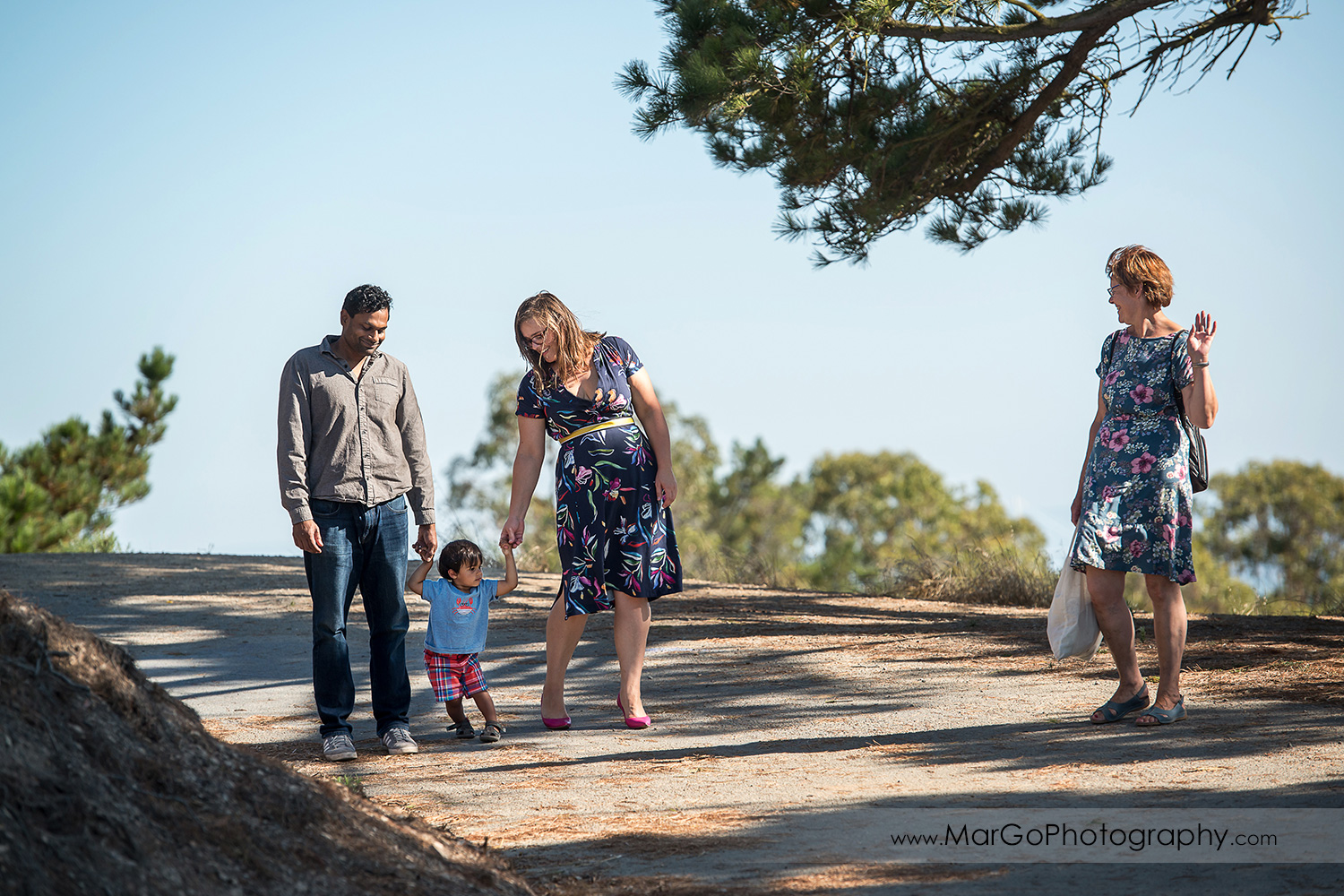 parents with little boy and grandmother walking at Richmond Marine View
