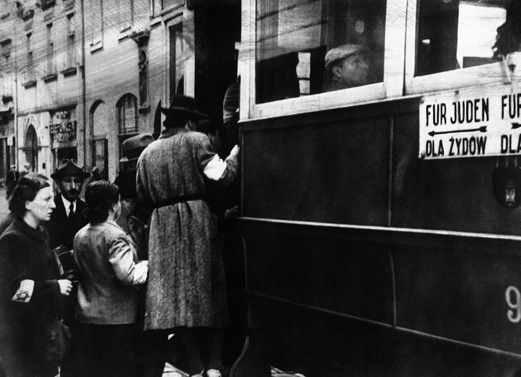 """. A scene in the Ghetto where the Jews are seen wearing white armlets bearing the Star of David and the trams are seen marked with the words \""""For Jews Only\"""" in Cracovia, Poland on Feb. 1, 1941. (AP Photo)"""