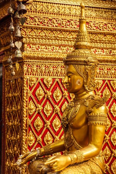 Sitting Buddha statue in Wat Phra That Doi Suthep, Chiang Mai, Thailand, Asia, Buddha, Buddhism, Buddhist, Buddhist temple, Chiang Mai, Thailand, Wat Phra That Doi Suthep, asian, gilded, god, gold, golden, lord, religion, religious building, sculpture, seated, sit, sitting, sitting Buddha, statuary, statue, temple, thai