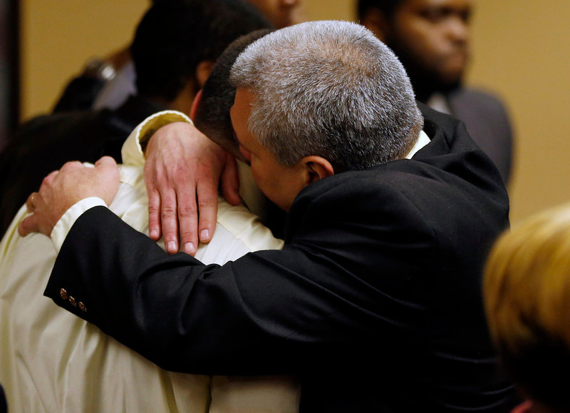 . Trent Mays\' father hugs him after hearing the verdict in juvenile court in Steubenville, Ohio, March 17, 2013. Mays, 17, and Ma\'lik Richmond, 16, were found guilty of raping a drunk classmate as she lay naked on a basement floor, too drunk to move or speak. REUTERS/Keith Srakocic/Pool