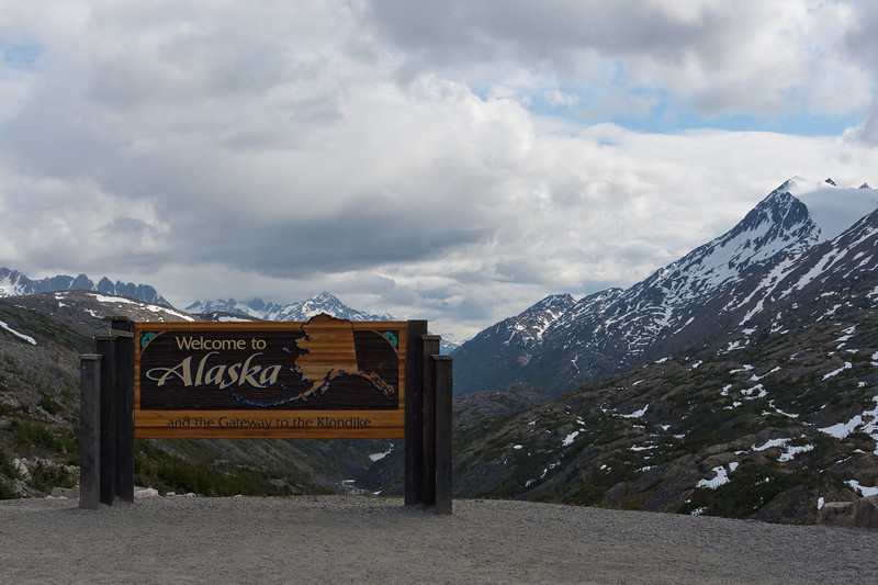 Tourist sign with view of snow-covered peak in Skagway, Alaska