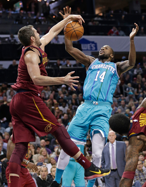 . Charlotte Hornets\' Michael Kidd-Gilchrist (14) is blocked by Cleveland Cavaliers\' Kevin Love (0) during the first half of an NBA basketball game in Charlotte, N.C., Wednesday, Nov. 15, 2017. (AP Photo/Chuck Burton)