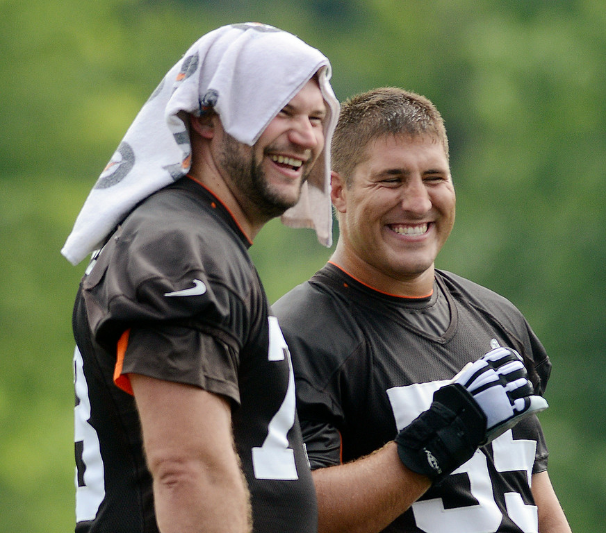. Duncan Scott/DScott@News-Herald.com Joe Thomas, left, and Alex Mack laugh during a break as the Cleveland Browns opened training camp on July 26 with their first practice at Browns headquarters in Berea.