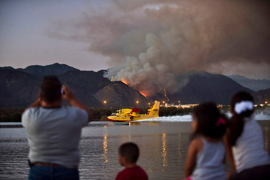 . A Super Scooper refills its water from Santa Fe Dam Recreational Area while battling a fire in Azusa Canyon on Monday evening, Sept. 23, 2013. (Photo by Watchara Phomicinda/ San Gabriel Valley Tribune)