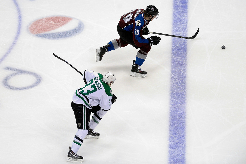 . Colorado Avalanche center Nathan MacKinnon (29) gets a breakaway opportunity as Dallas Stars defenseman Alex Goligoski (33) defends during the second period. (Photo by AAron Ontiveroz/The Denver Post)