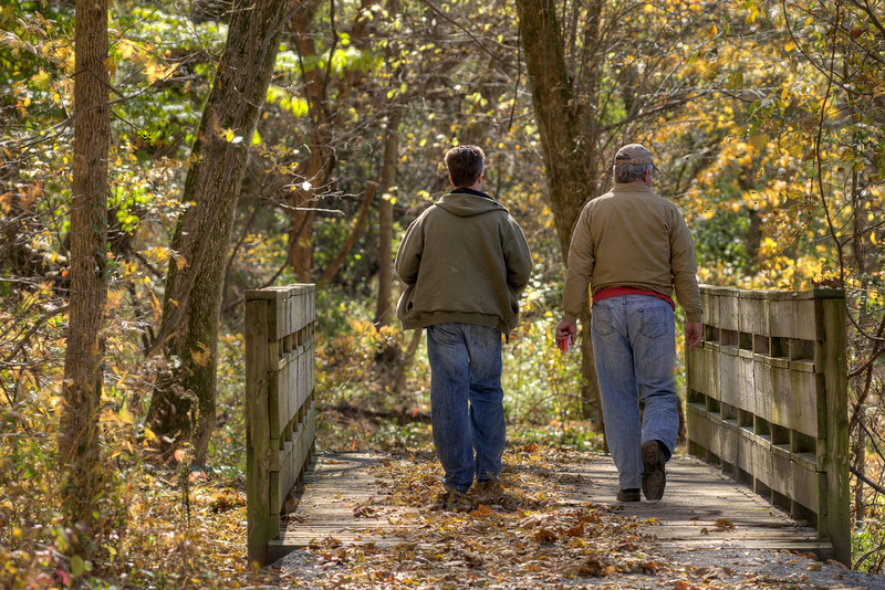 A pair of men take a walk along the leaf-covered trail along the Watauga River at Sycamore Shoals State Park in Elizabethton, TN on Friday, November 1, 2013. Copyright 2013 Jason Barnette