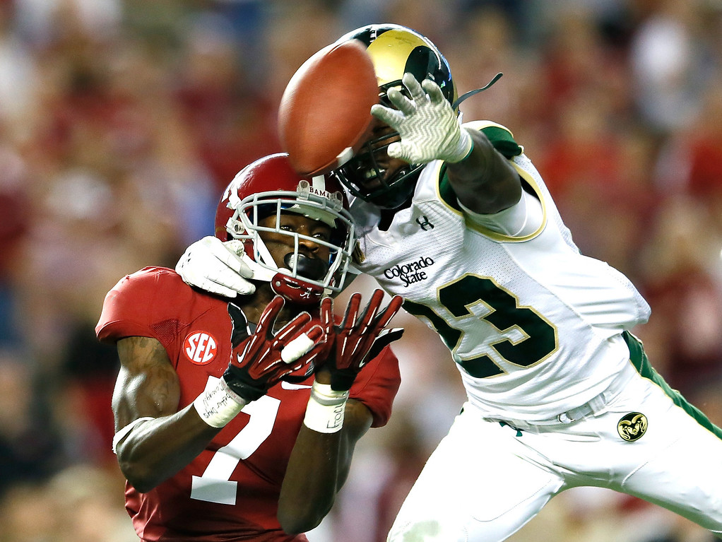 . TUSCALOOSA, AL - SEPTEMBER 21:  Bernard Blake #23 of the Colorado State Rams is called for pass interference as he breaks up this pass intended for Kenny Bell #7 of the Alabama Crimson Tide at Bryant-Denny Stadium on September 21, 2013 in Tuscaloosa, Alabama.  (Photo by Kevin C. Cox/Getty Images)