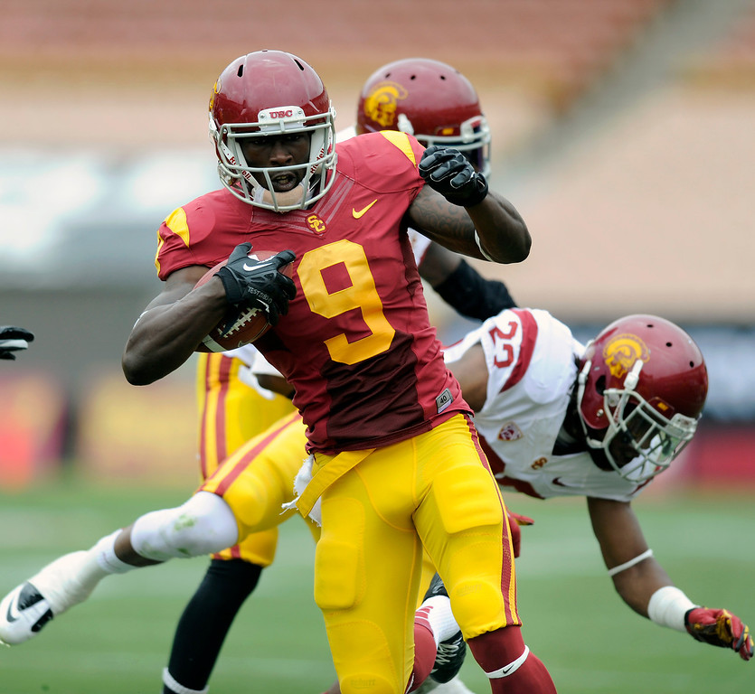 . WR Marqise Lee runs for yardage after a pass reception during USC\'s Spring Football Game at the L.A. Memorial Coliseum, Saturday, April 13, 2013. (Michael Owen Baker/Staff Photographer)
