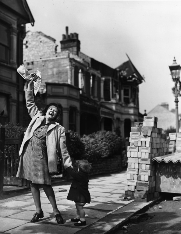 . 7th May 1945:  Mrs Pat Burgess of Palmer\'s Green, north London is thrilled to get the news that her husband will soon be home for good from Germany.  (Photo by Reg Speller/Fox Photos/Getty Images)
