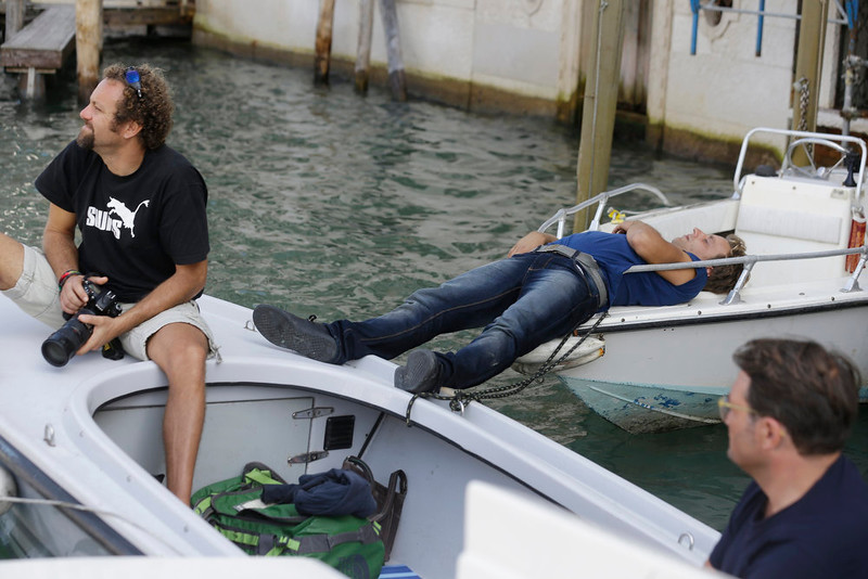 . The owner of a boat rests as photographers wait for George Clooney and his wife Amal Alamuddin outside the Aman luxury Hotel in Venice, Italy, Sunday, Sept. 28, 2014. George Clooney married human rights lawyer Amal Alamuddin Saturday, the actor\'s representative said, out of sight of pursuing paparazzi and adoring crowds. (AP Photo/Luca Bruno)