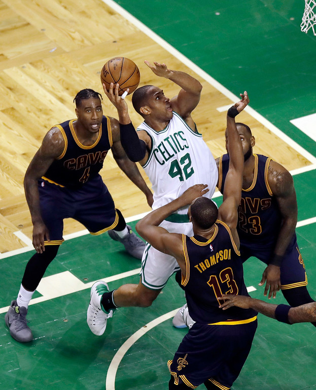. Cleveland Cavaliers defenders Iman Shumpert (4), Tristan Thompson (13) and LeBron James, right, surround Boston Celtics center Al Horford (42) as he tries to get off a shot during the second quarter of Game 1 of the NBA basketball Eastern Conference finals, Wednesday, May 17, 2017, in Boston. (AP Photo/Charles Krupa)