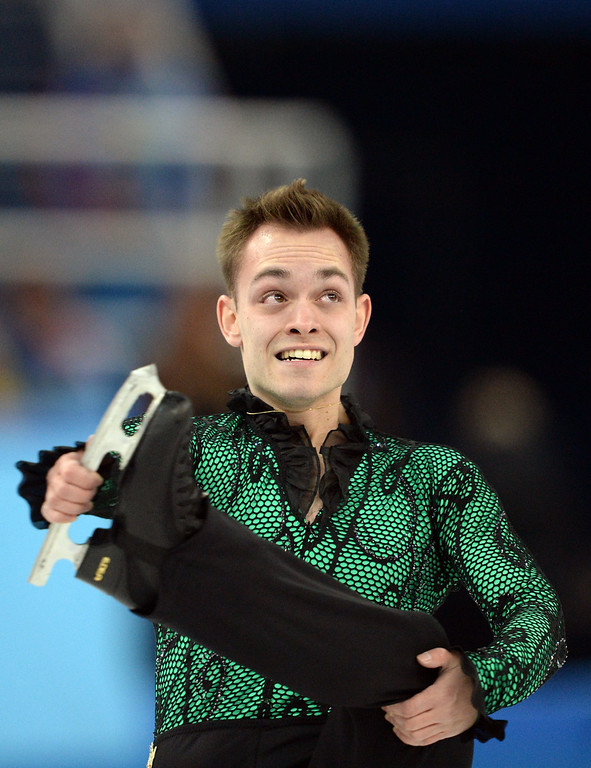 . Italy\'s Paul Bonifacio Parkinson performs during the Men\'s Figure Skating Short Program at the Iceberg Skating Palace during the Sochi Winter Olympics on February 13, 2014.  YURI KADOBNOV/AFP/Getty Images