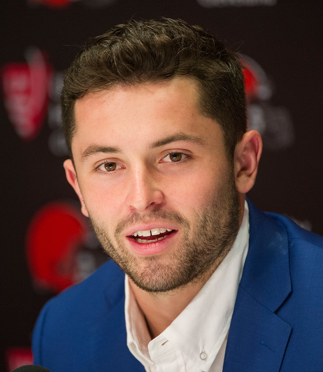 . Cleveland Browns first-round NFL football draft selection Baker Mayfield answers a question during a news conference at the team\'s headquarters in Berea, Ohio, Friday, April 27, 2018. (AP Photo/Phil Long)