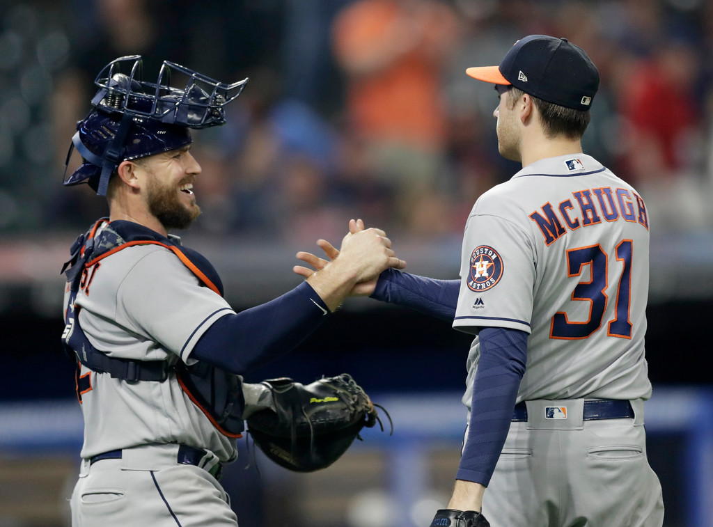 . Houston Astros relief pitcher Collin McHugh, right, is congratulated by catcher Brian McCann after the Astros defeated the Cleveland Indians 8-2 in a baseball game Thursday, May 24, 2018, in Cleveland. (AP Photo/Tony Dejak)