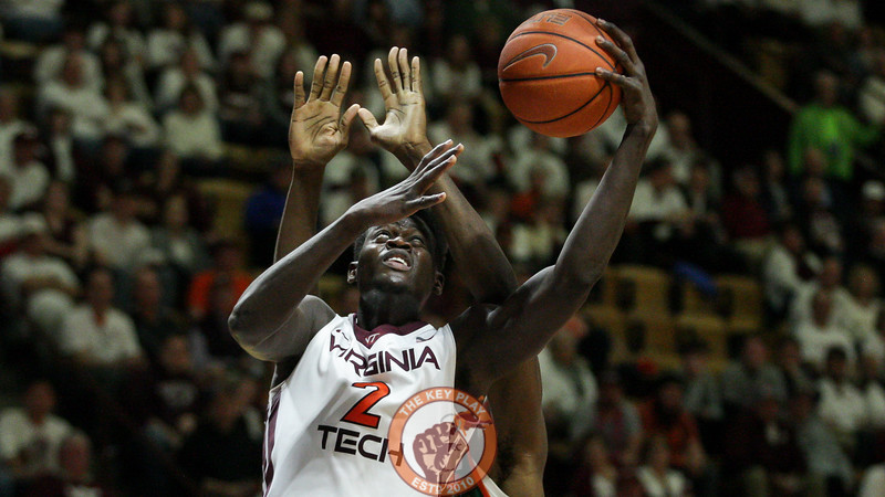 Khadim Sy is fouled from behind on a layup attempt. (Mark Umansky/TheKeyPlay.com)