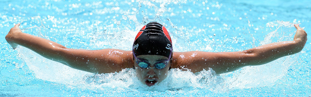 . Glendora\'s Alexis Margett wins the 100 yard butterfly during the Division 2 CIF Southern Section Swimming Championships in the Riverside Aquatics Complex at Riverside City College in Riverside, Calif., on Saturday, May 17, 2014.  (Keith Birmingham/Pasadena Star-News)