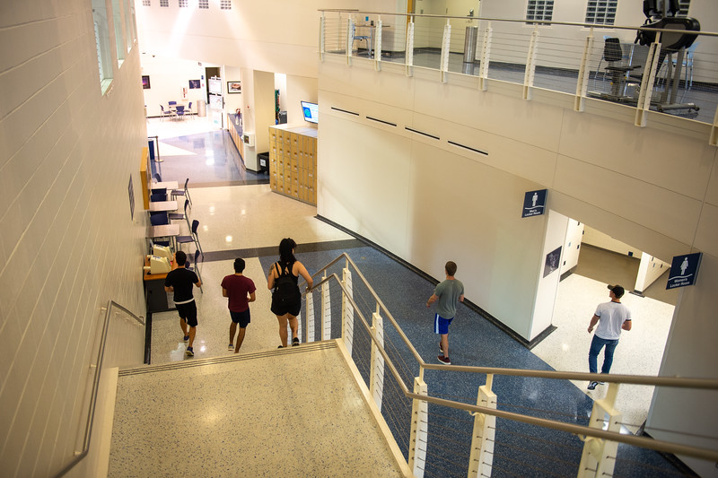 Students take time to work out in the Dugan Wellness Center.
