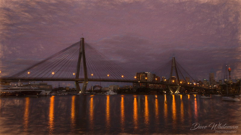 Anzac Bridge and Blackwattle Bay at dusk.