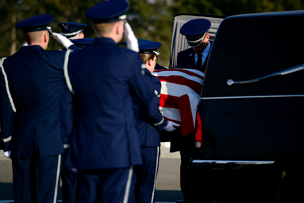 . The Honor Guard removes the coffin of Colonel Fitzroy Newsum during his funeral service at Fort Logan National Cemetery on Monday, January 14, 2013. Newsum, who was 94, served as a Tuskegee Airman during his military service. AAron Ontiveroz, The Denver Post